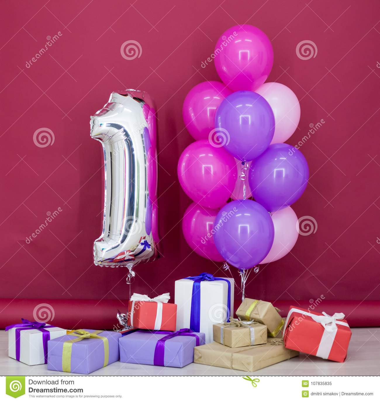 Balloons Of Different Colors With Gifts For Her Birthday