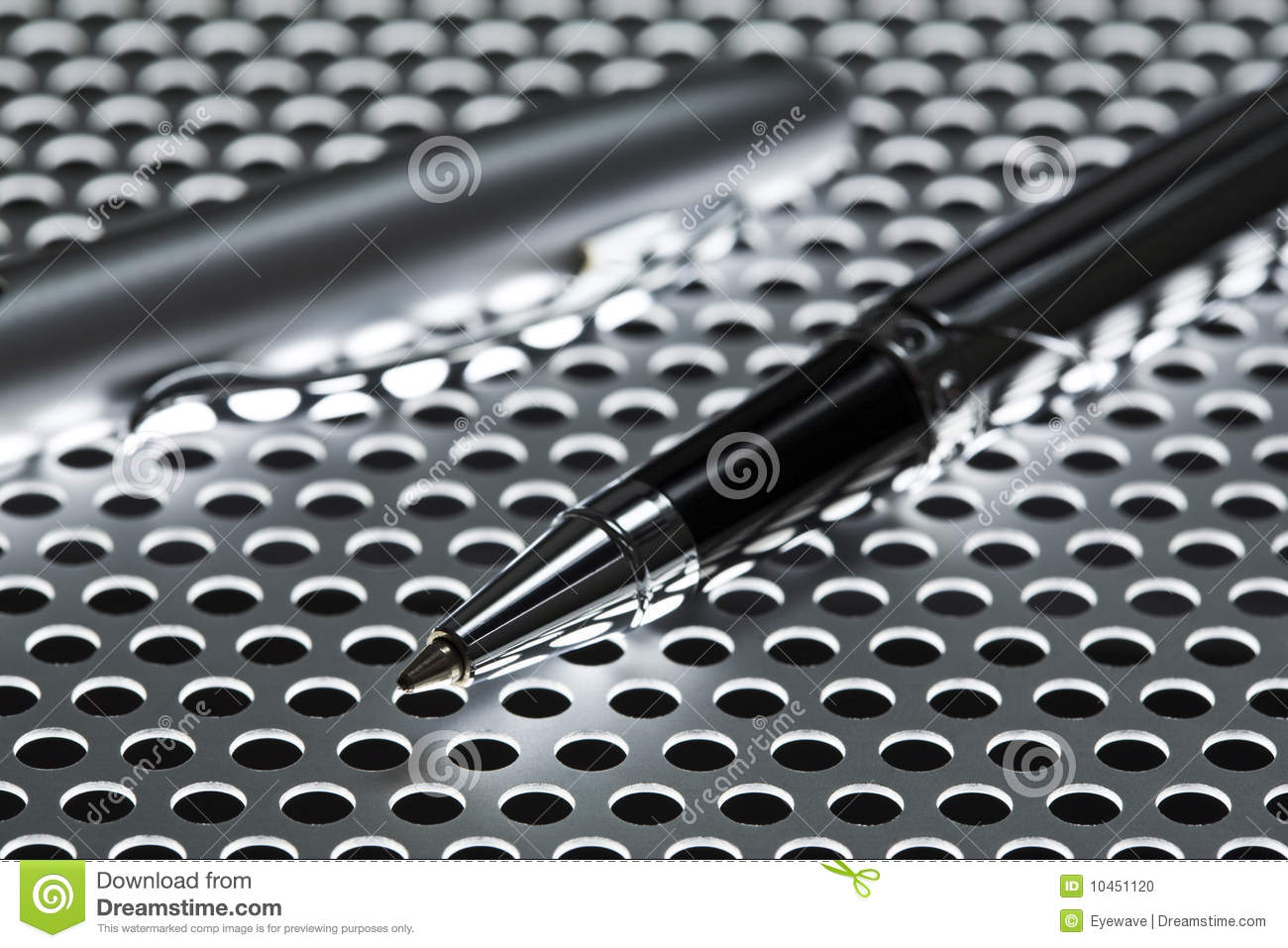 Ballpoint Pen On Perforated Metal Sheet Stock Photo
