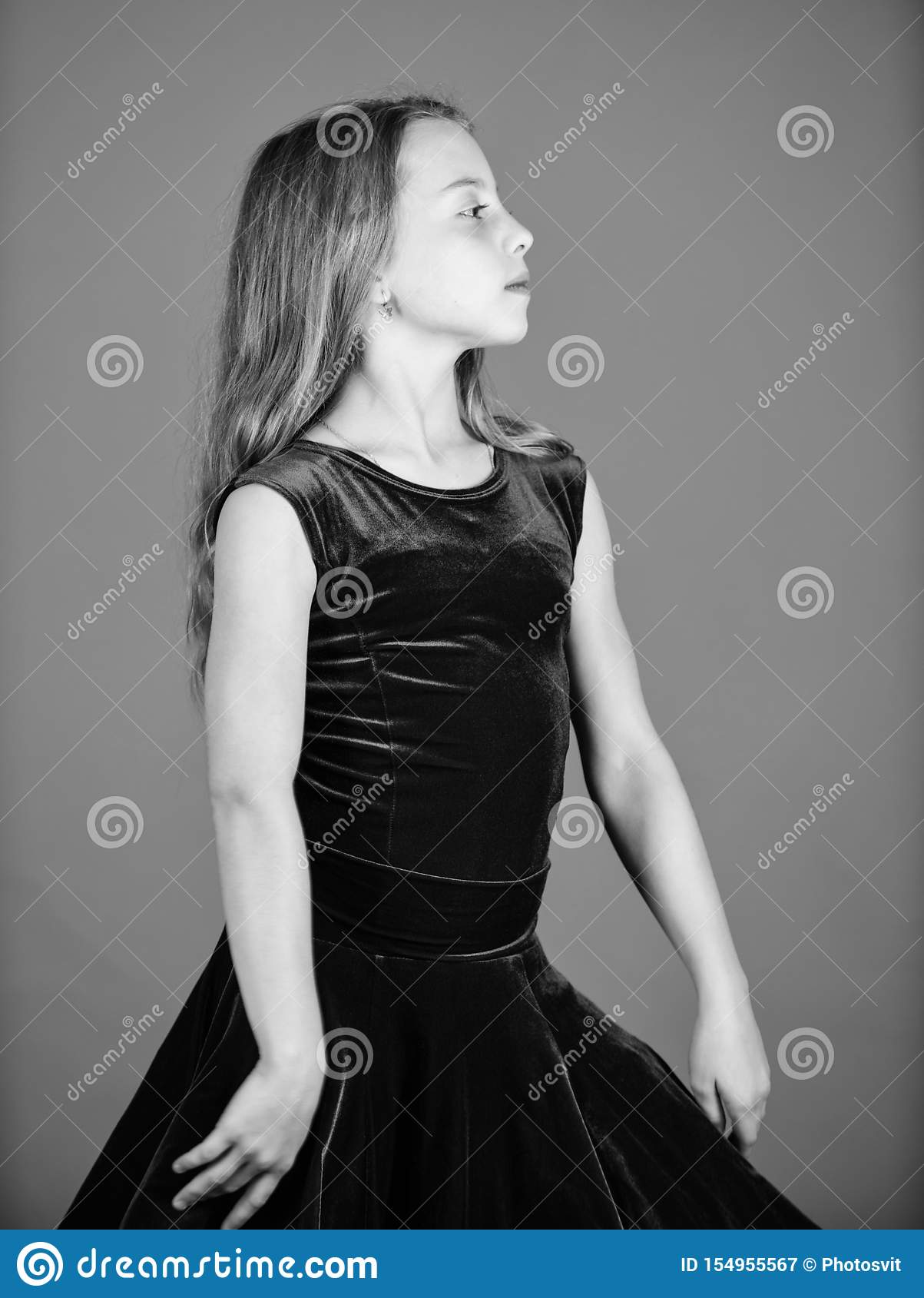 Ballroom dancewear fashion concept. Kid dancer satisfied with concert outfit. Clothes for ballroom dance. Ballroom