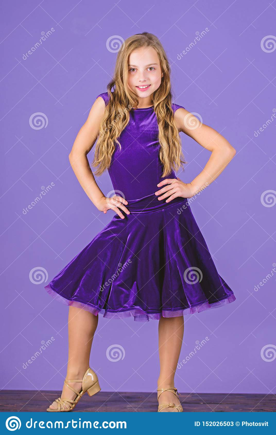 Ballroom fashion. Girl child wear velvet violet dress. Clothes for ballroom dance. Kid fashionable dress looks adorable