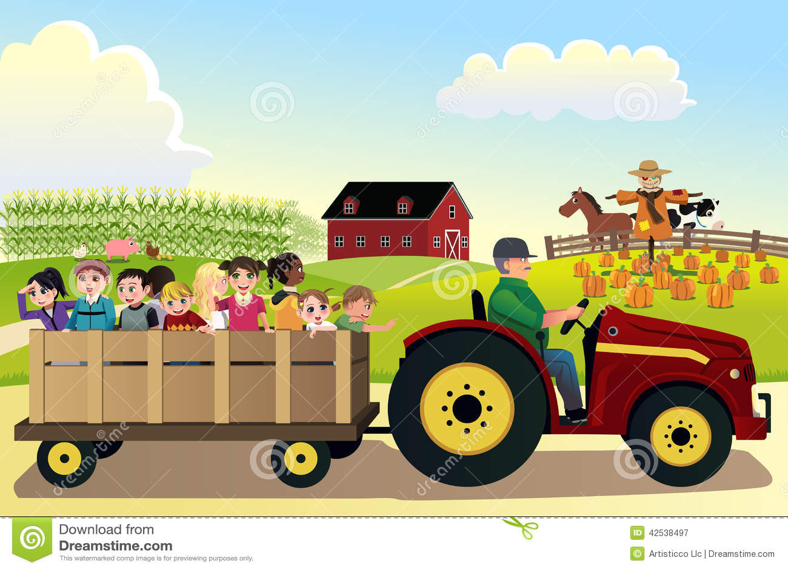 Bambini che vanno su un hayride in un azienda agricola con i campi di grano nel backgr