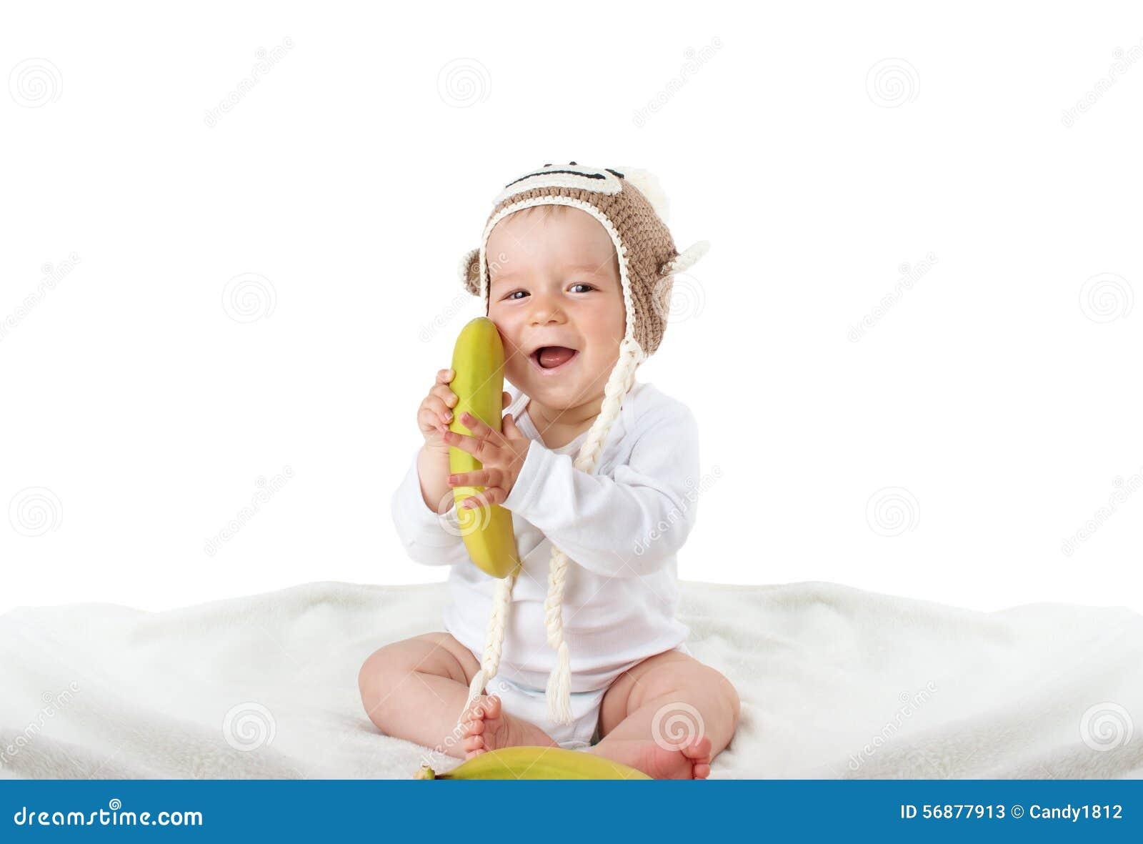 Bambino in cappello della scimmia