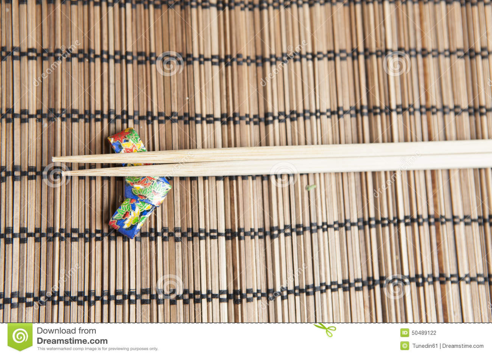 Bamboo Chopsticks On A Handmade Origami Chopstick Holder Stock Photo