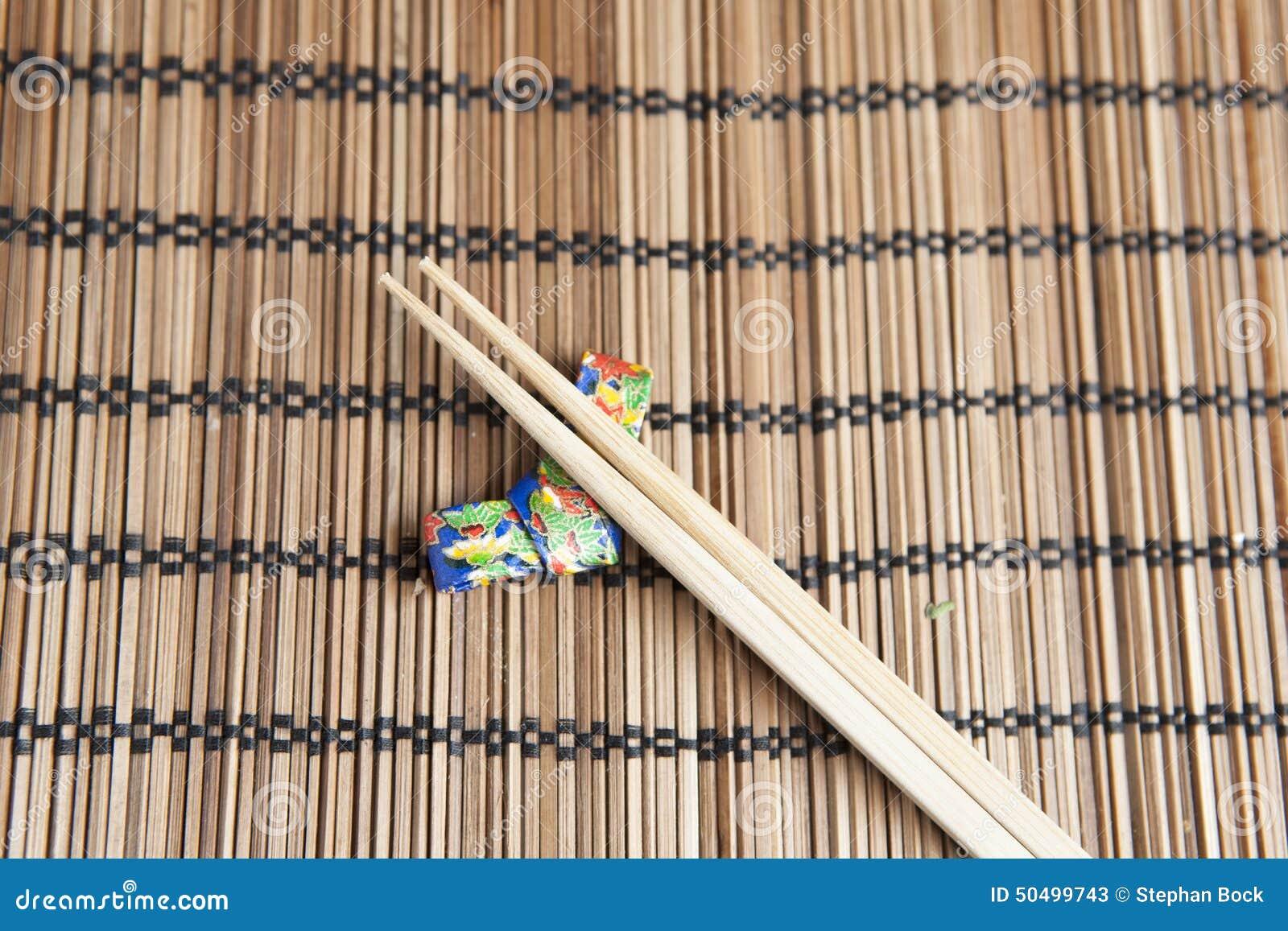 Bamboo Chopsticks On A Handmade Origami Chopstick Holder Stock Image