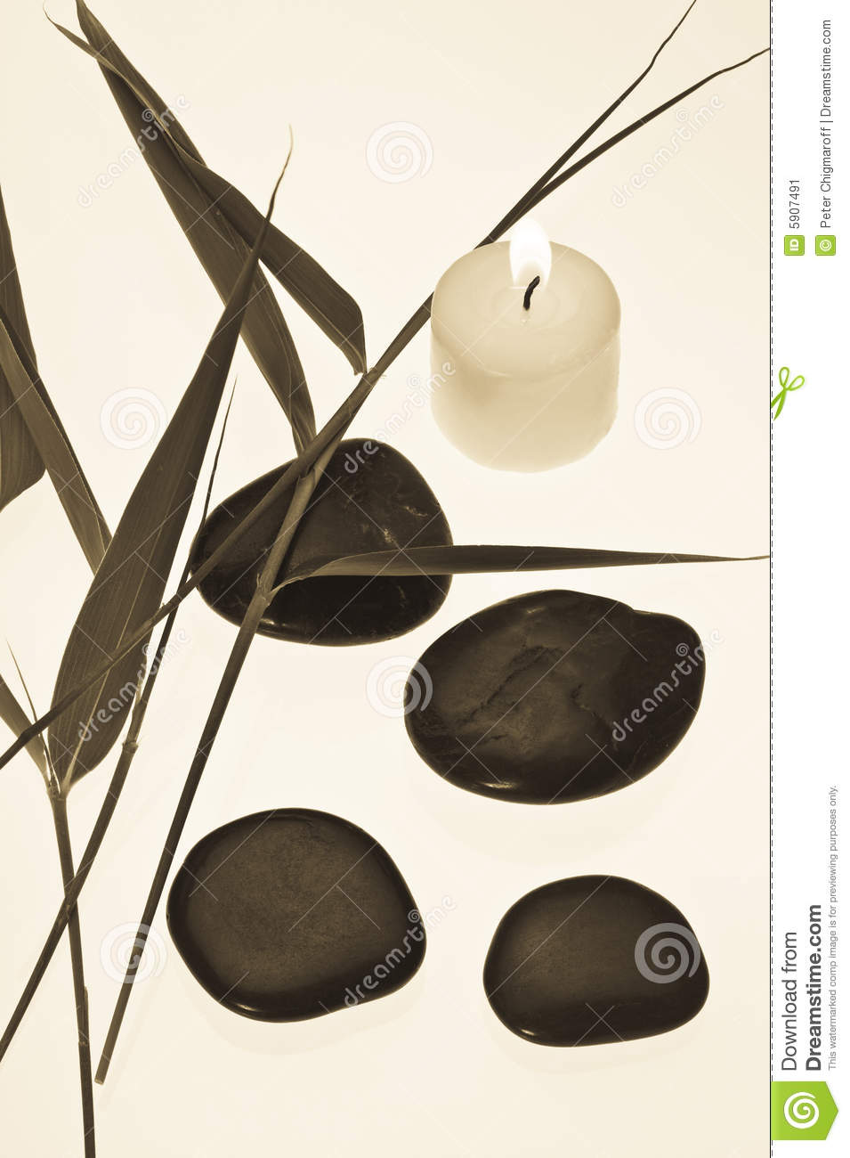 bamboo leaves candle and shiny black stone stock image