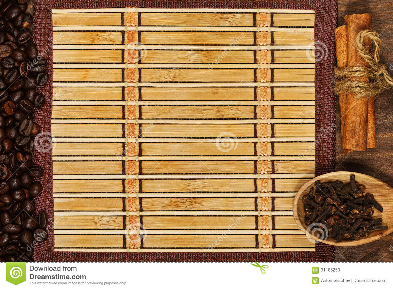 Bamboo mat with frame of coffee beans and condiments