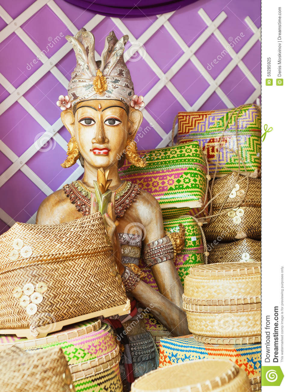 Bamboo offering boxes and traditional ceremonial balinese man figure