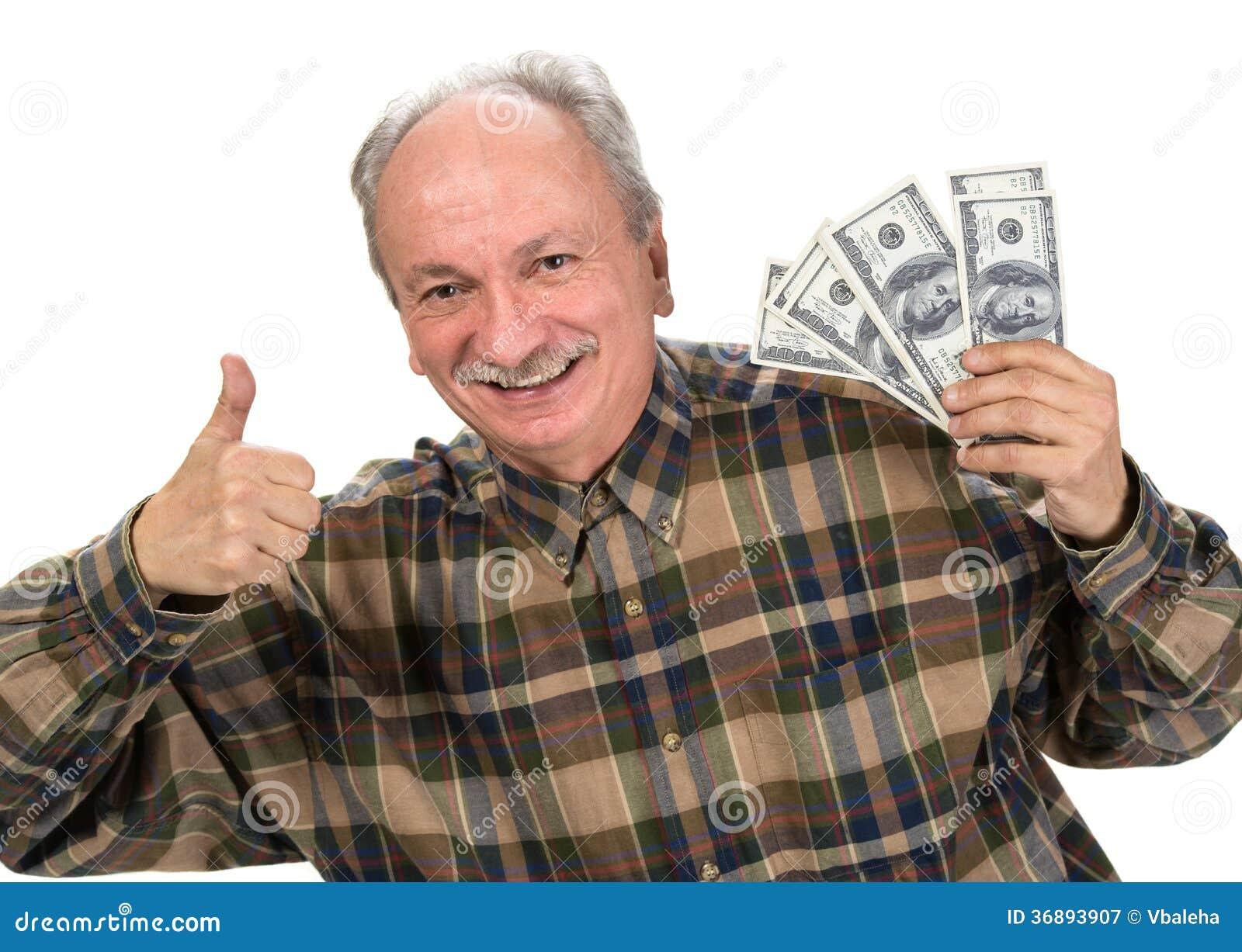 Download Banconote In Dollari Della Tenuta Dell'uomo Senior Immagine Stock - Immagine di ecciti, felice: 36893907
