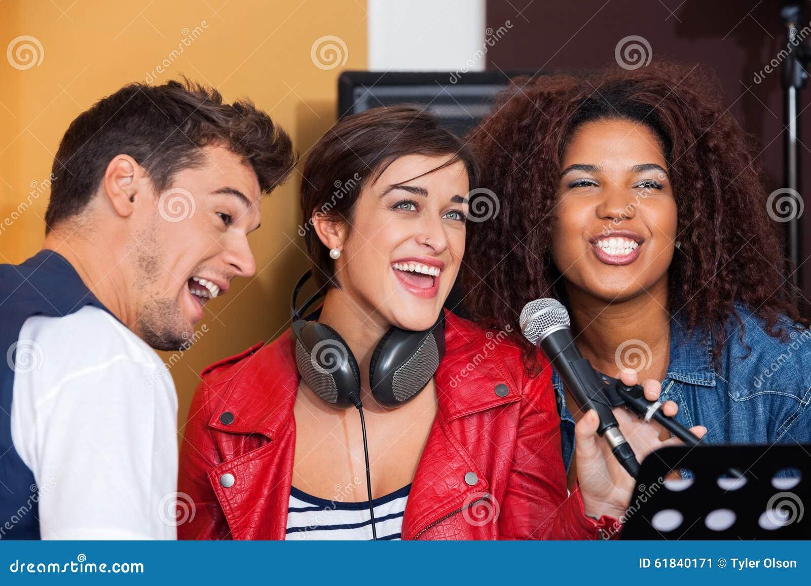 Band Members Singing In Recording Studio