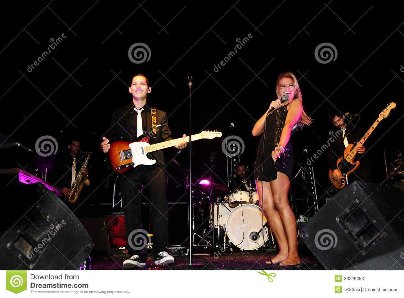 Band On Stage With Female Singer Editorial Stock Photo ...