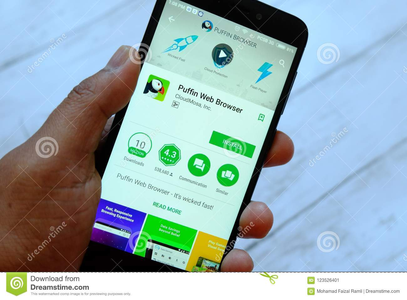 BANDAR SERI BEGAWAN,BRUNEI - JULY 25TH,2018 : A male hand holding smartphone with Puffin browser app on an android Play Store