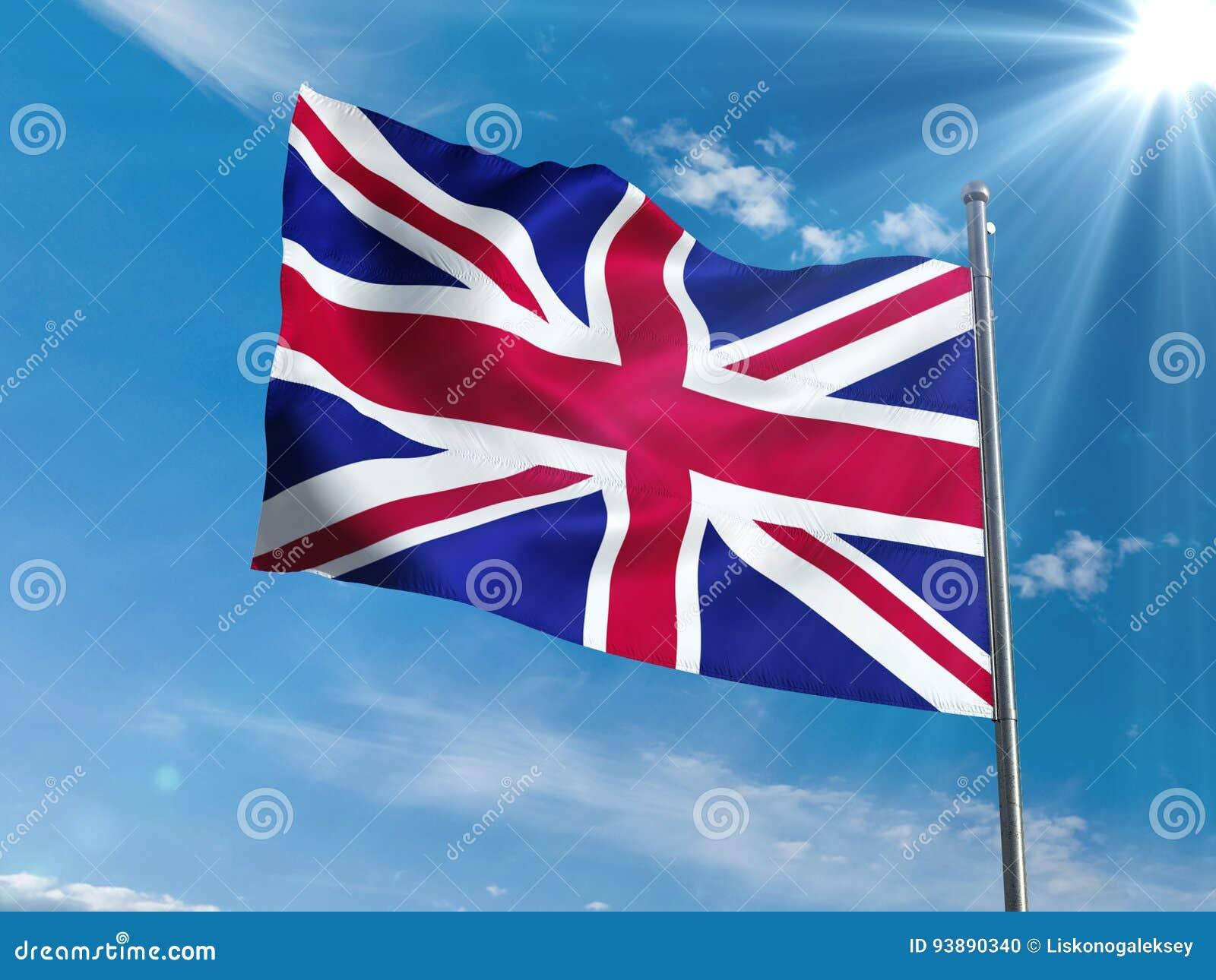 Bandeira britânica que acena no céu azul com sol