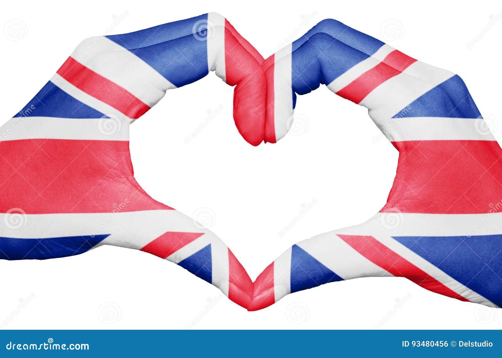 Bandeira de Reino Unido pintada nas mãos que formam um coração isolado no fundo branco, no nacional BRITÂNICO e no conceito do pa