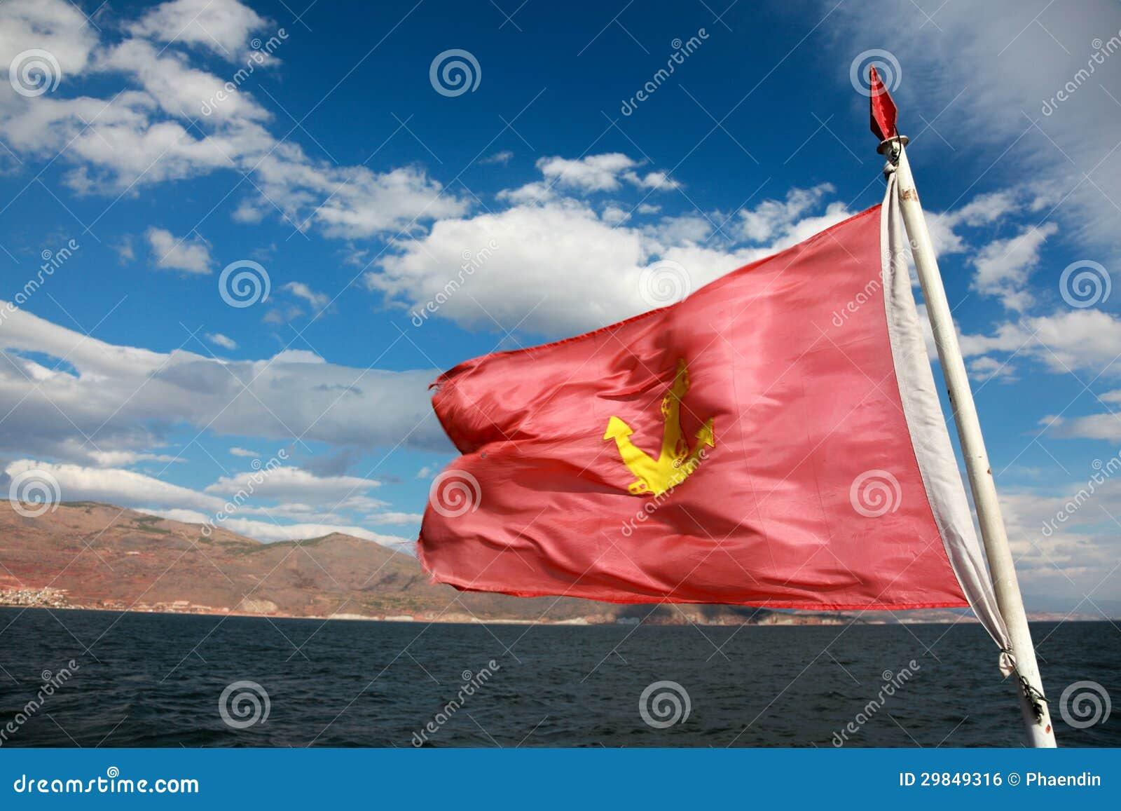 Bandeira vermelha com sinal da âncora