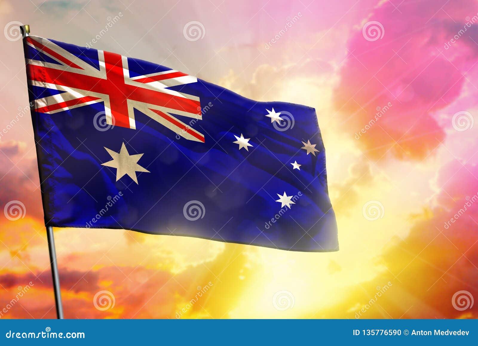 Bandera de Australia que agita en fondo colorido hermoso de la puesta del sol o de la salida del sol Diversa bola 3d