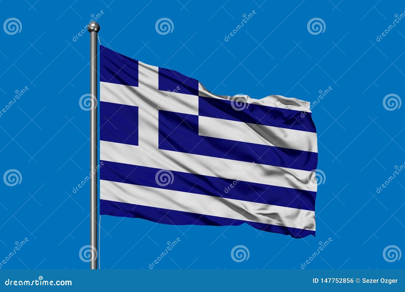 Bandera de Grecia que agita en el viento contra el cielo azul profundo Indicador griego