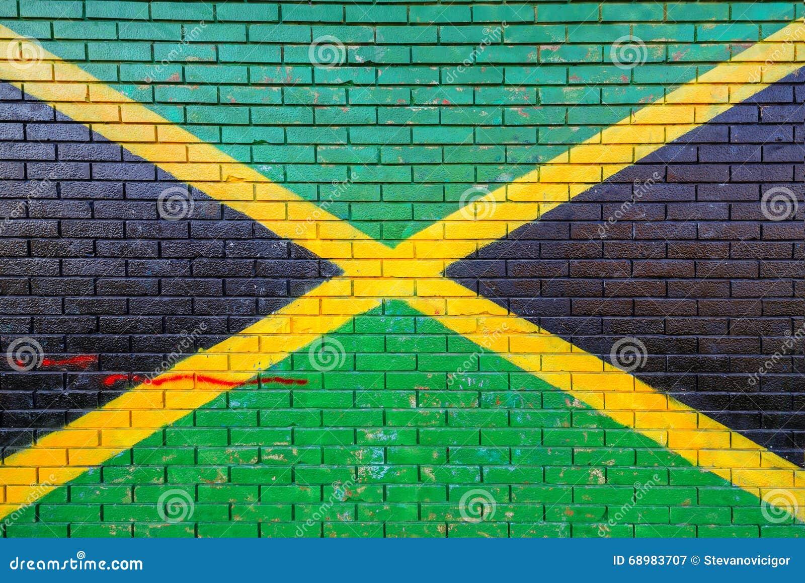 Bandera de Jamaica pintada en la pared de ladrillo