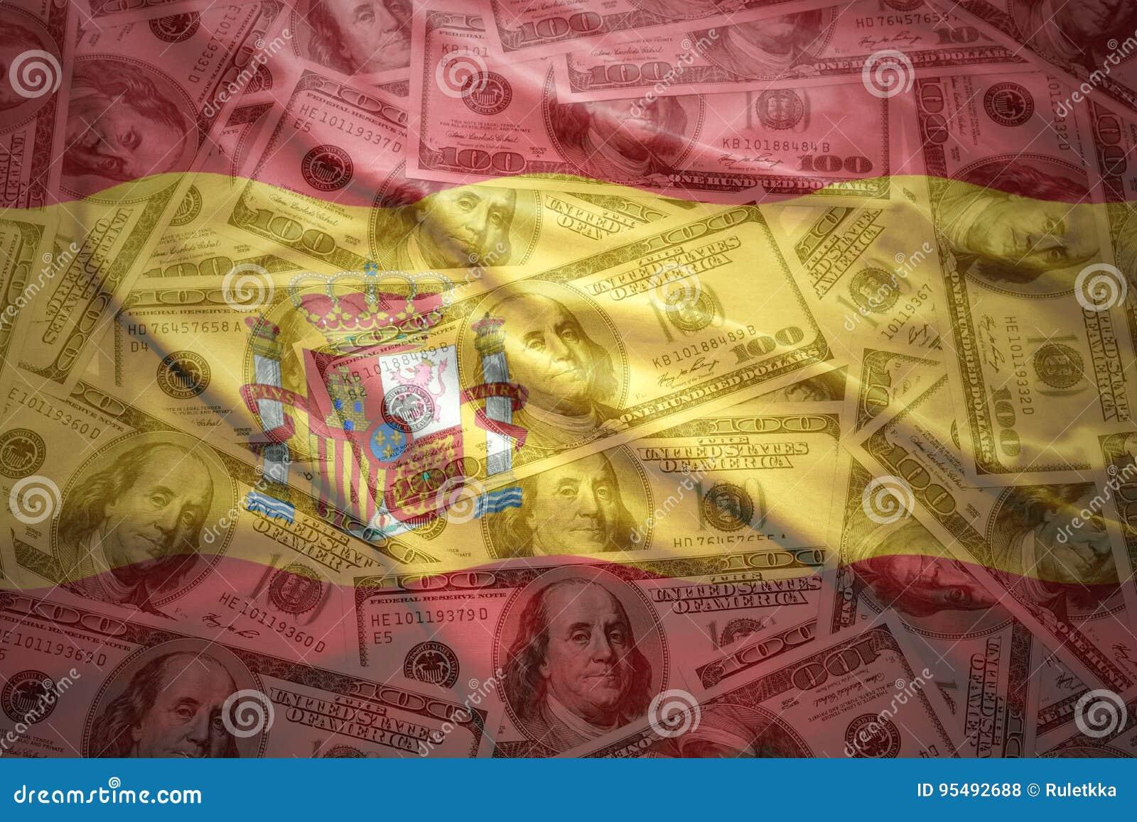 Bandera española que agita colorida en un fondo del dinero del dólar