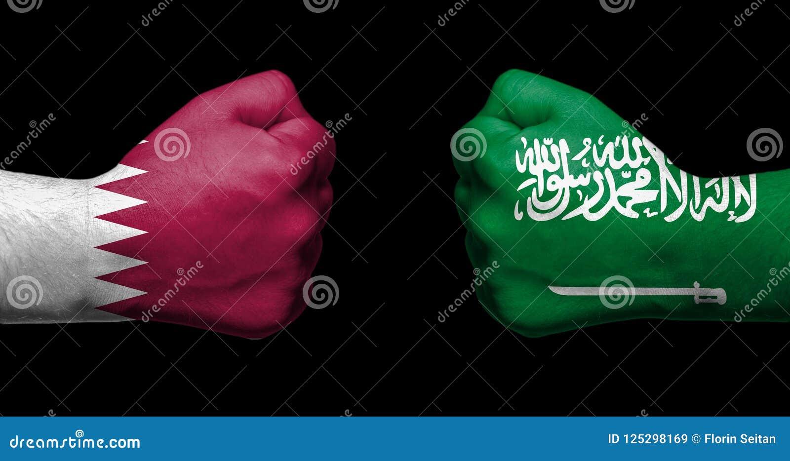 Banderas de Qatar y de United Arab Emirates pintados en dos apretados
