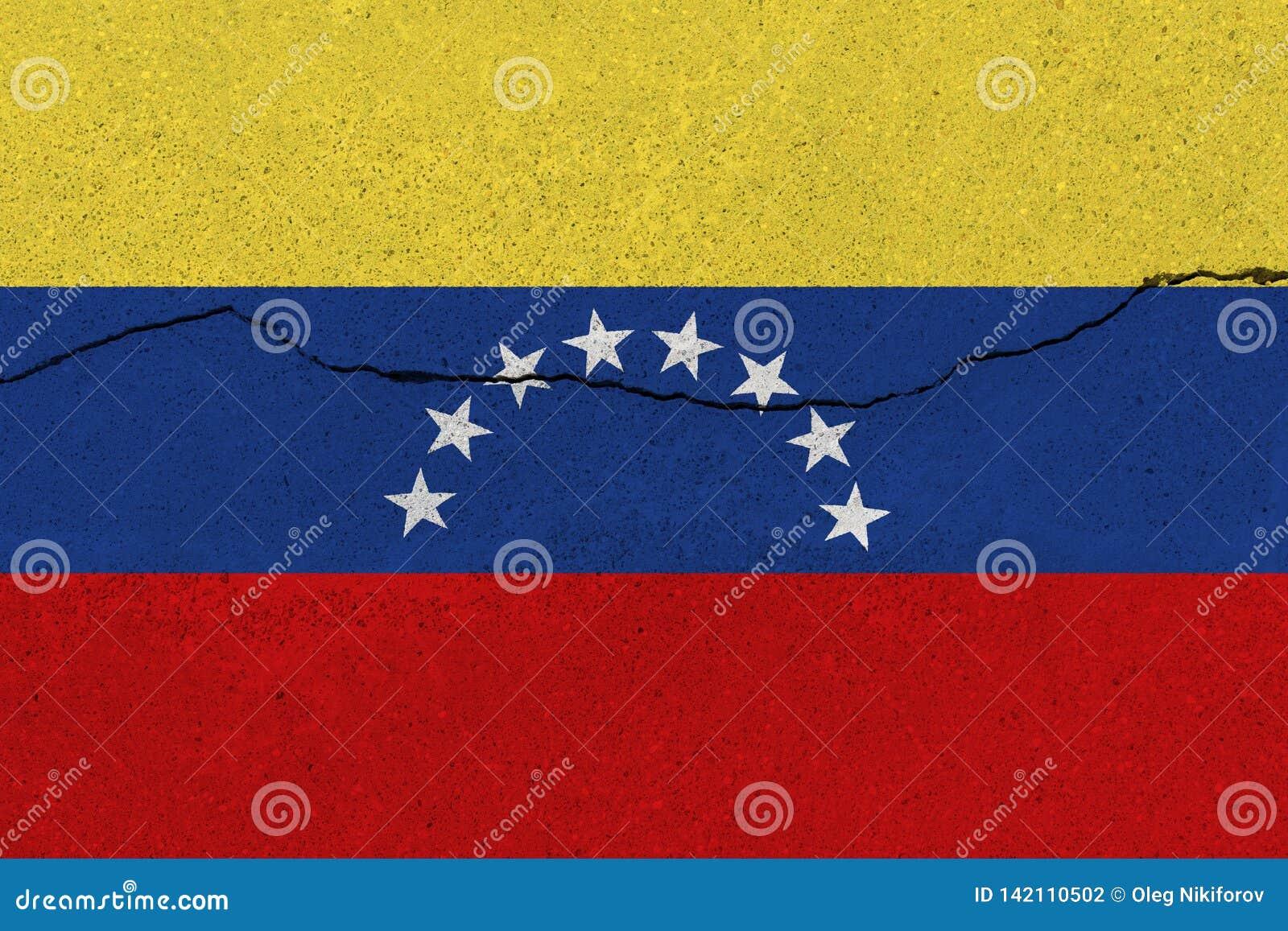 Bandiera del Venezuela sul muro di cemento con la crepa