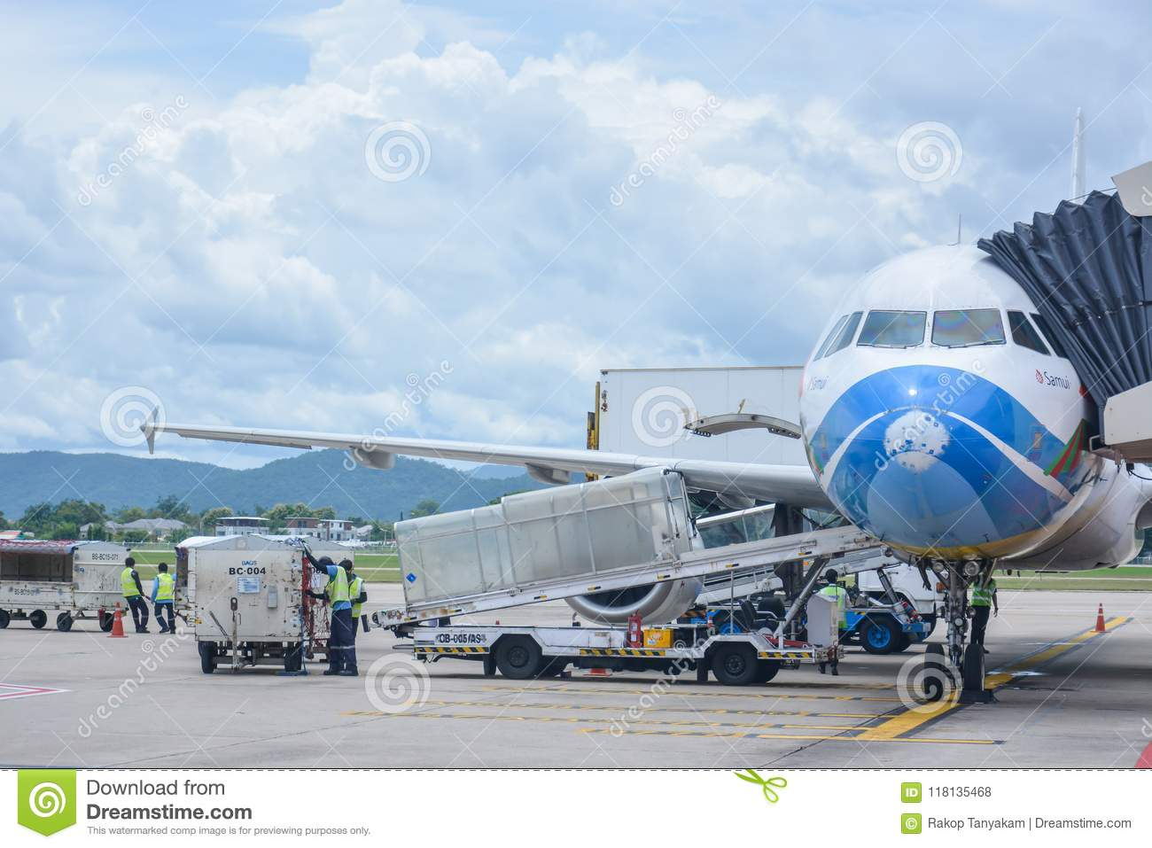 Bangkok Airways plane loading baggage and ready to fly