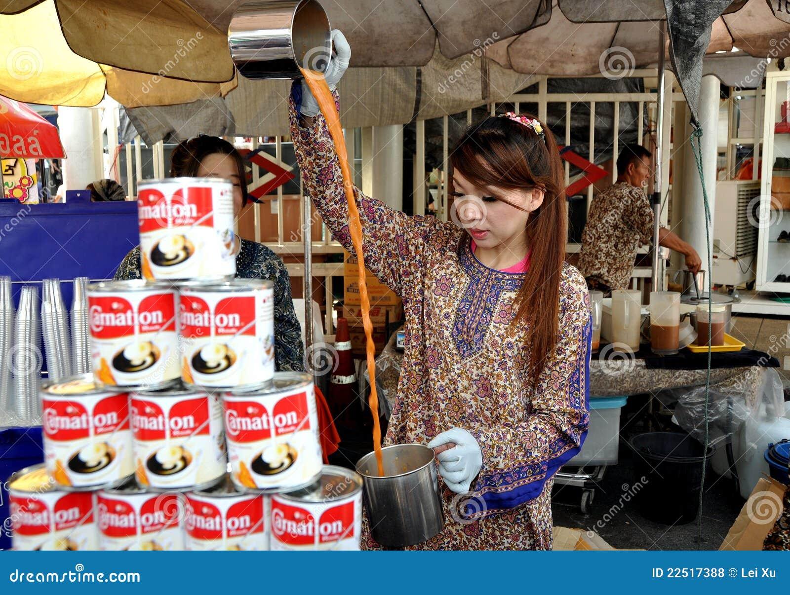 Bangkok double som gör den teathailand kvinnan