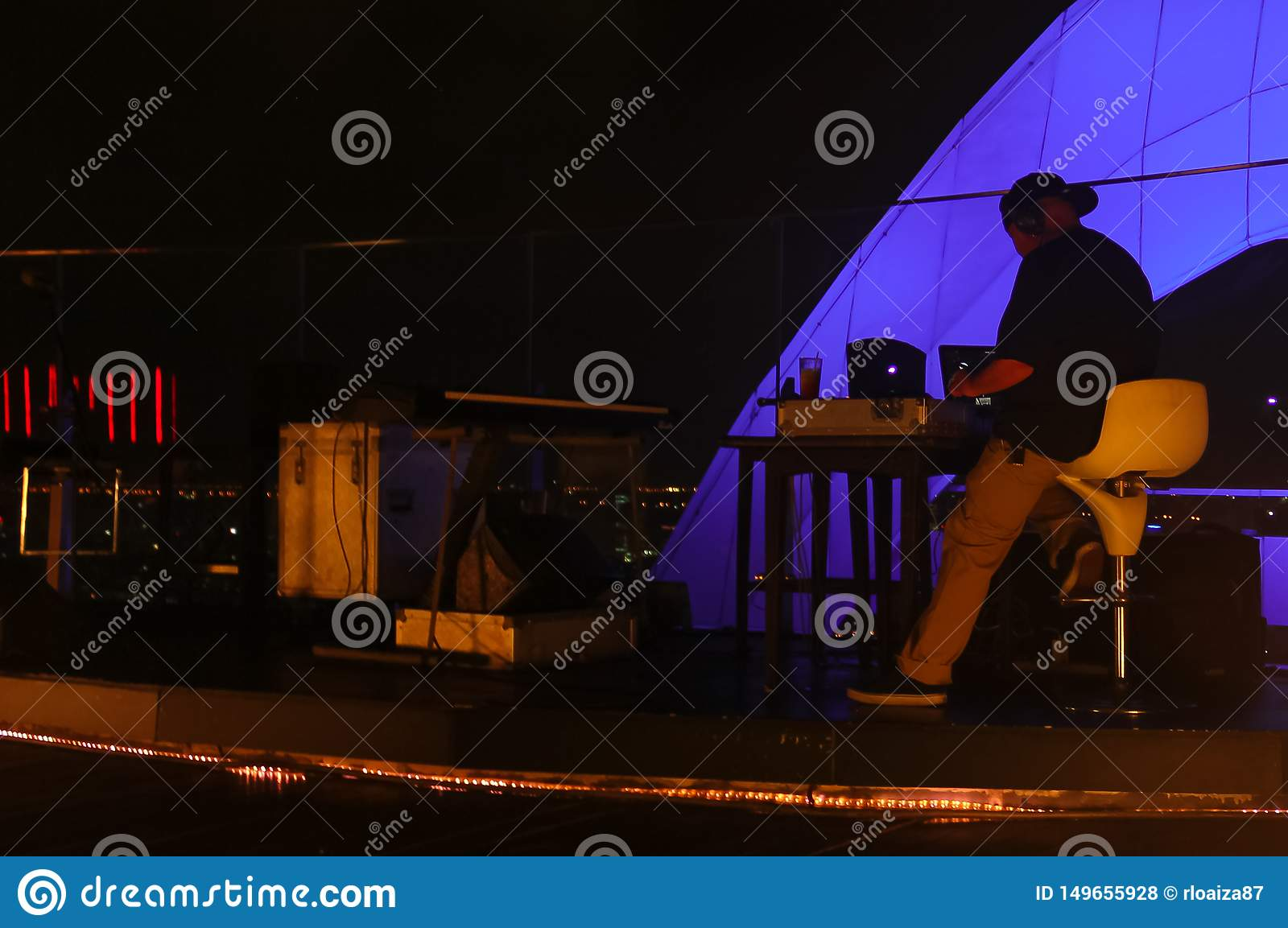 Bangkok, Thailand - April 28, 2014. Disk Jockey or DJ getting ready for a night out on a terrace in bangkok thailand