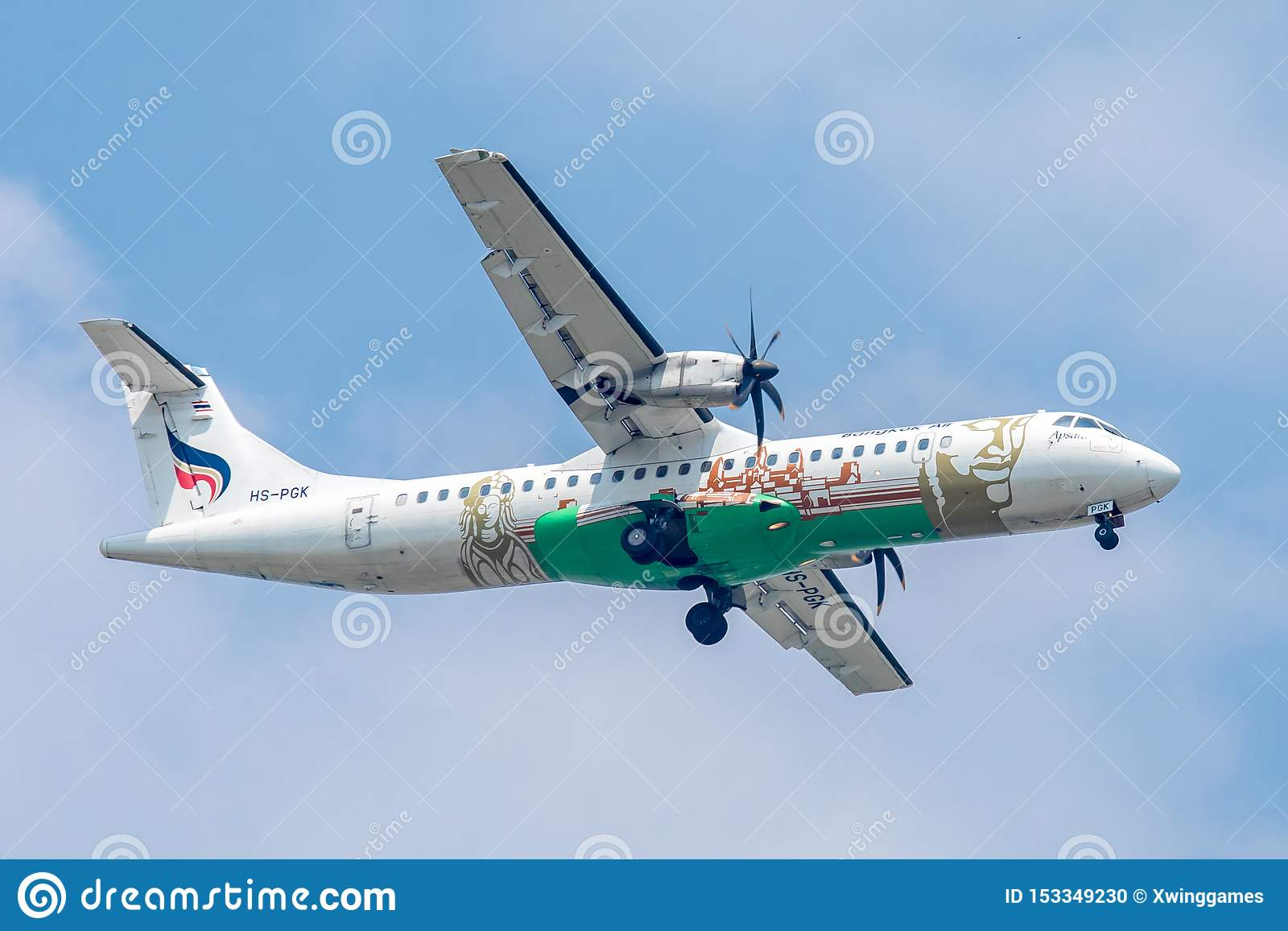 Propeller aircraft or Plane of Bangkok Airways on the sky landing to Suvanabhumi airport.