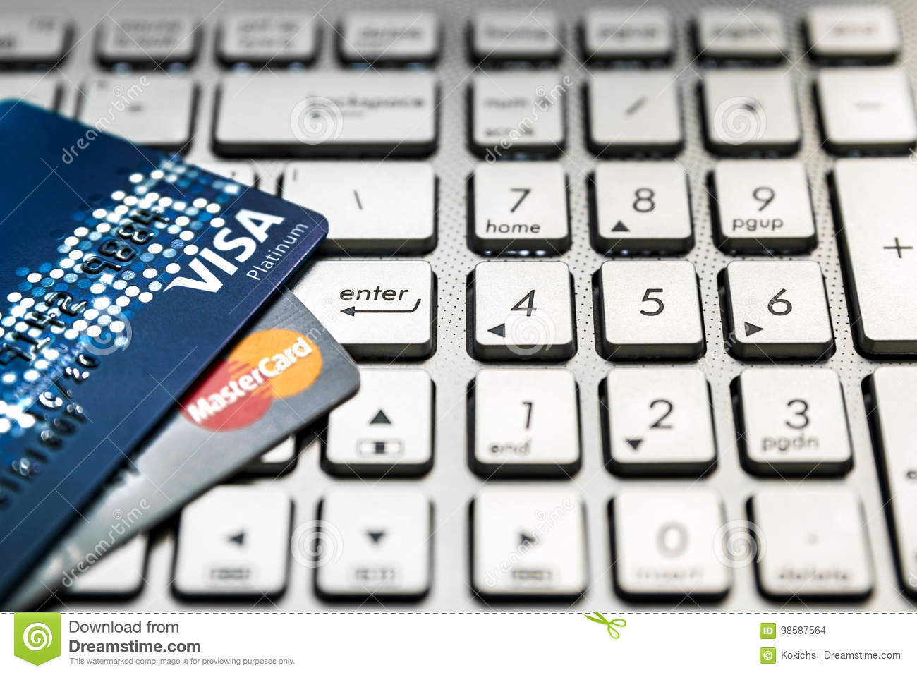 Bangkok, Thailand - August 24, 2017: Close up shot of 2 credit cards VISA and Mastercard on laptop computer with enter button focu