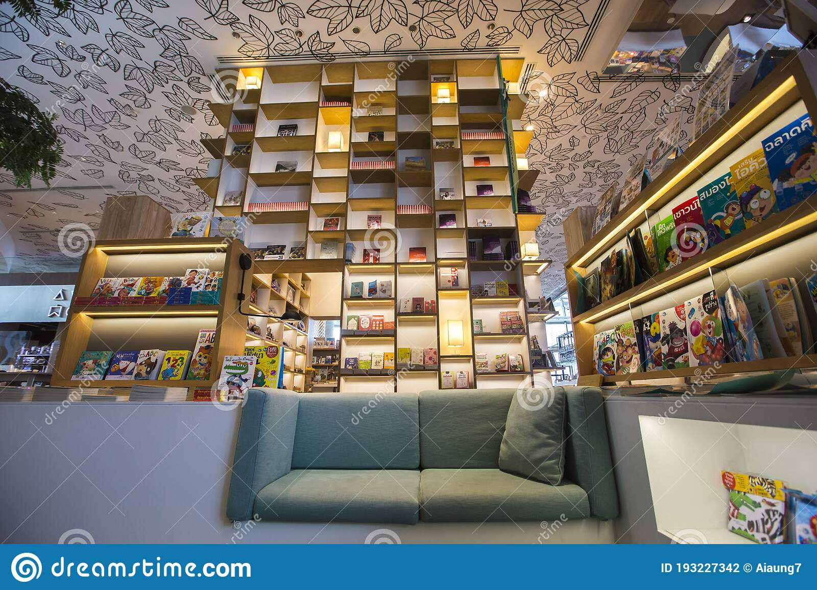 Bangkok Thailand August 7 2020 Trendy And Modern Bookstore High Bookshelf With Green Sofa Lights Painting Leaves On Ceiling Editorial Photography Image Of Ceiling Elegant 193227342