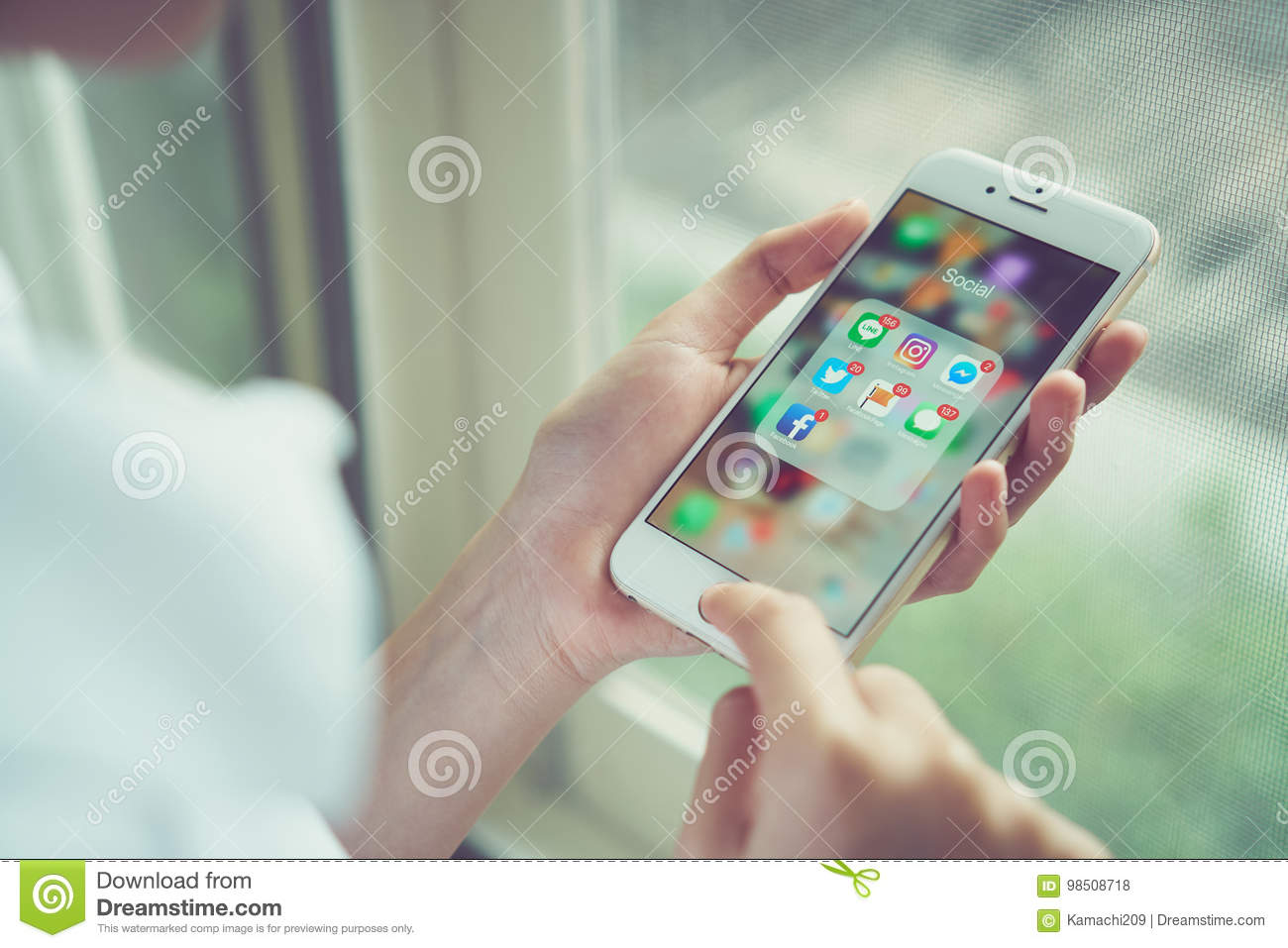 Bangkok, Thailand - August 23, 2017 : woman using iPhone of show display app Social media screen. The phone is a daily necessity.
