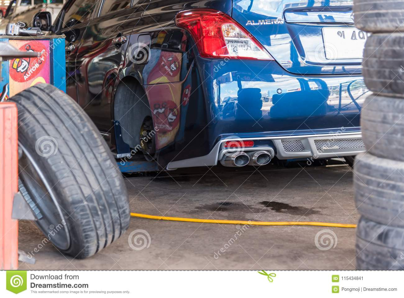 Checking A Car Suspension For Repair At Car Garage Editorial