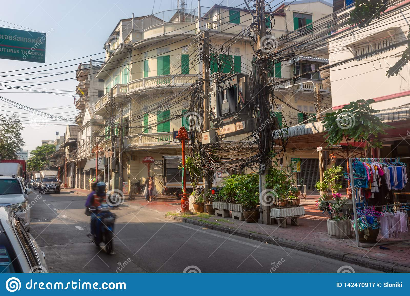 Bangkok, Thailand - February 14 2019 : Bike on the china town street .Twisted electrical wires on the streets of Bangkok