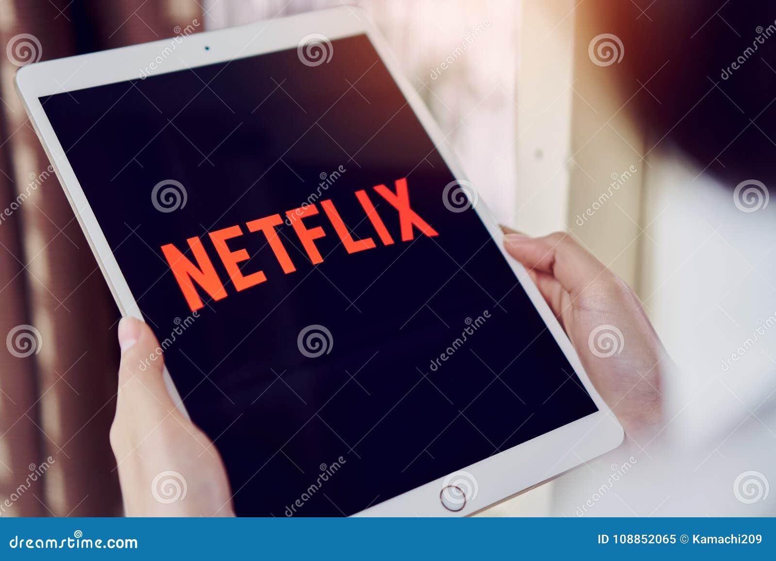 Bangkok, Thailand - January 31, 2018 : Netflix app on tablet screen. Netflix is an international leading subscription service.