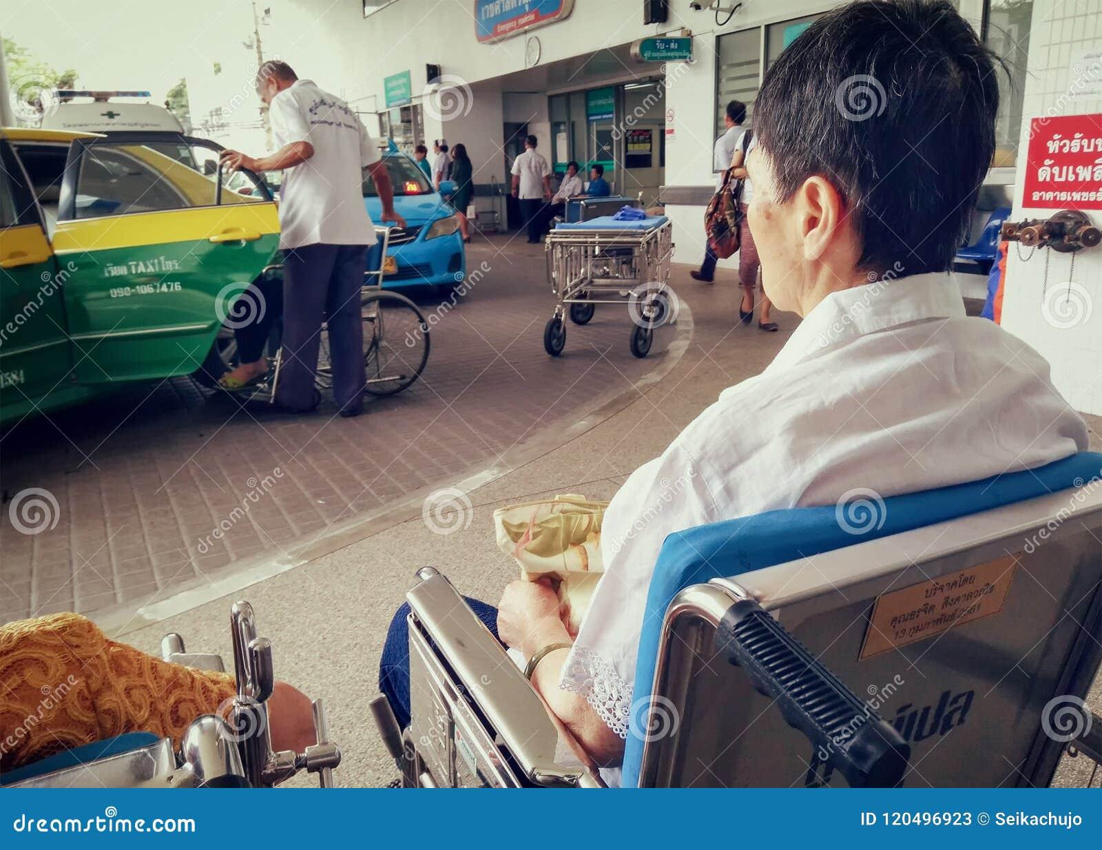 BANGKOK, THAILAND - JUNE 21: An unidentified elderly waits for t