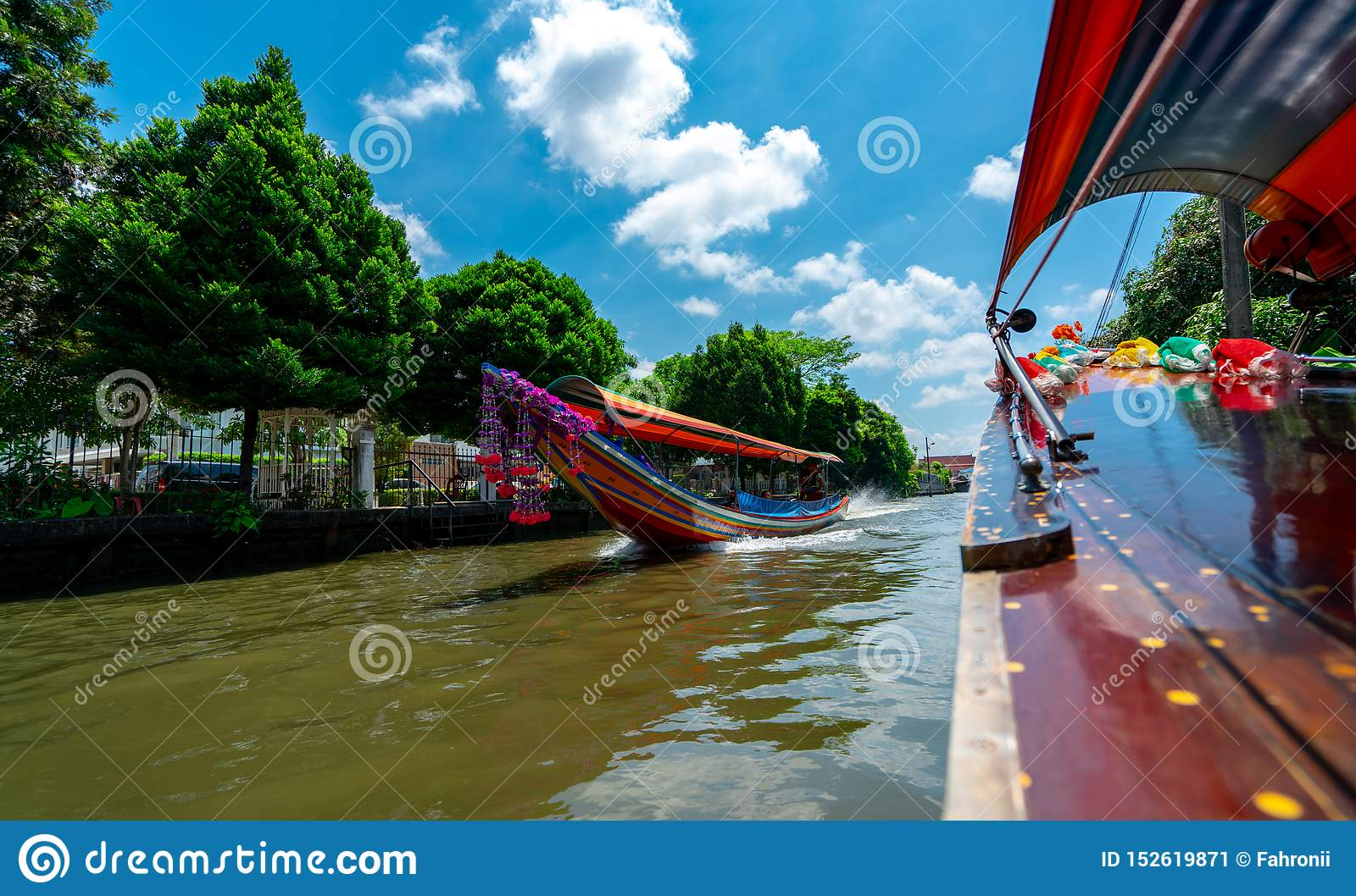 Tourist Travel By Boat To Watching Waterfront Building And