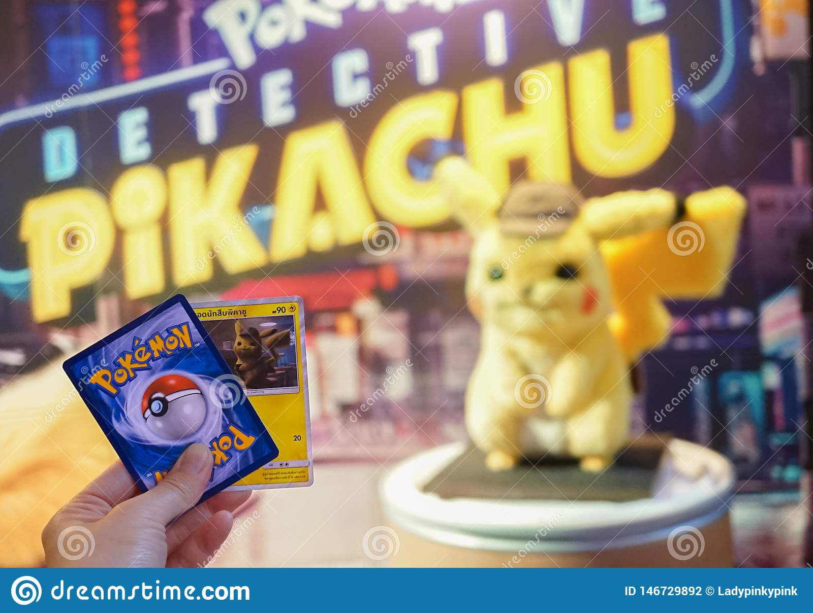 Bangkok Thailand May 4 2019 A Photo Of A Hand Holding Pokemon Card Game Pokemon Detective Pikachu Movie Standee In Front Of Editorial Photography Image Of Famous Cinema 146729892