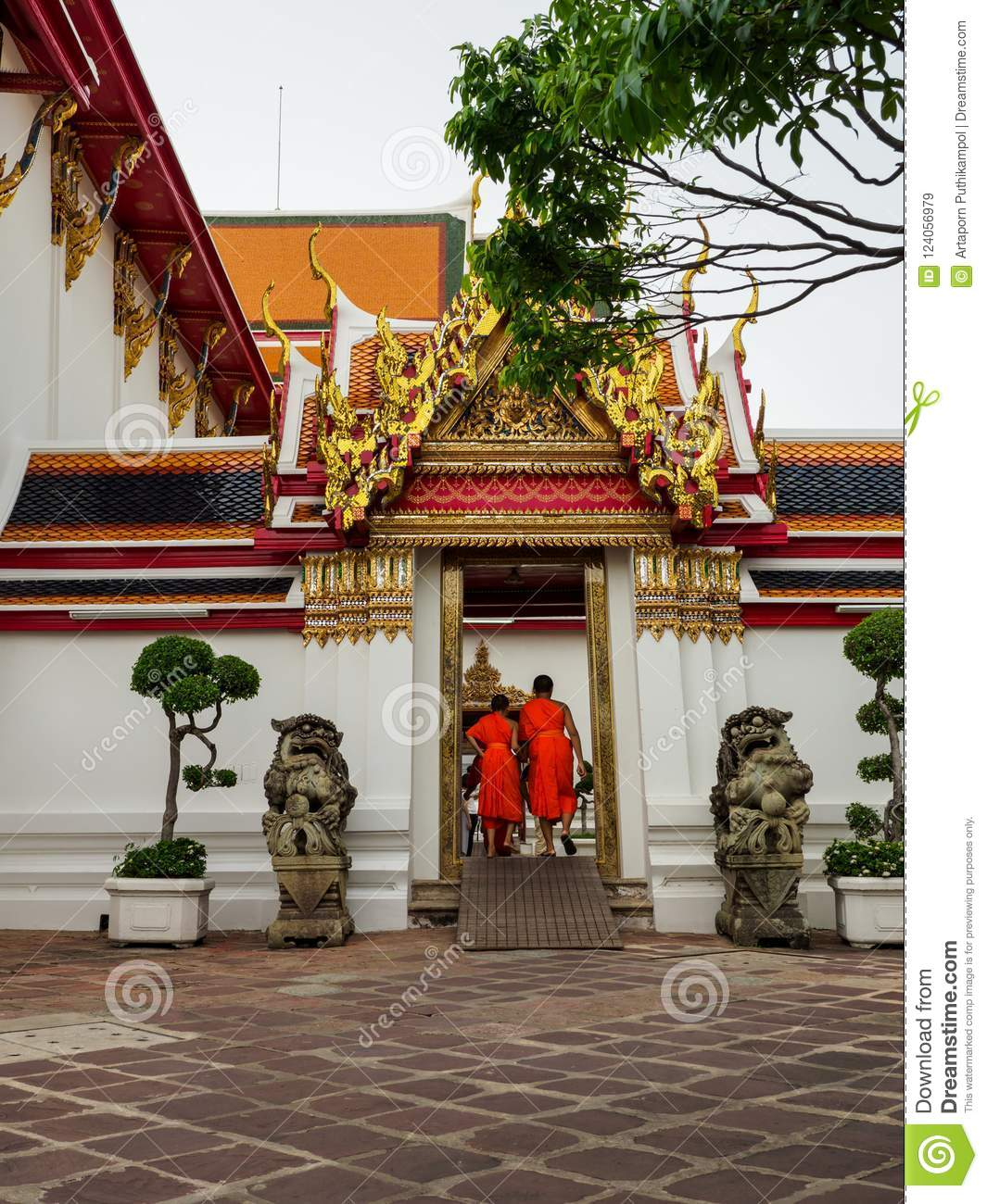 The Novice Monks Entering The Side Entrance Of Wat Pho Temple In