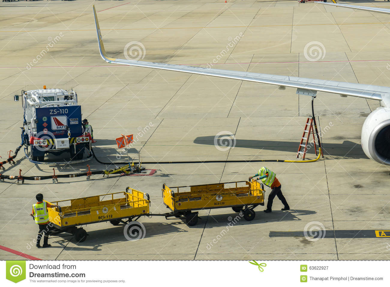 Bangkok, Thailand - 29 October 2015 : Ground Crews are working at the Terminal of Don Mueang Internation Airport (DMK)