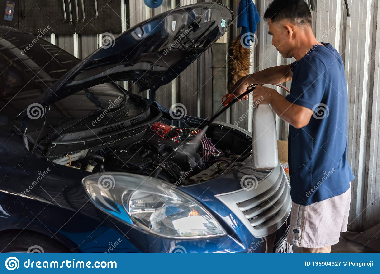 Checking A Car Engine For Repair At Car Garage Editorial