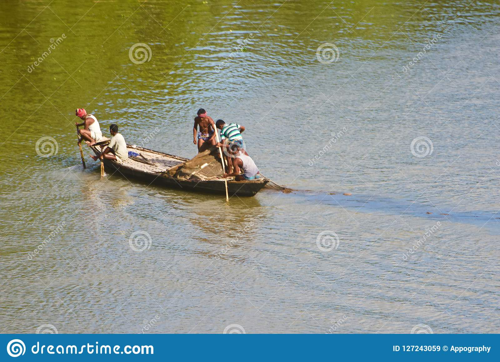 Bangladeshi people fishing on a boat in the river unique photo