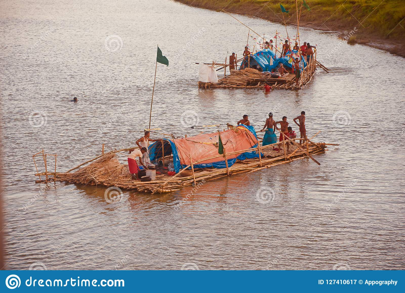 People travelling on a traditional boat in the river unique photo