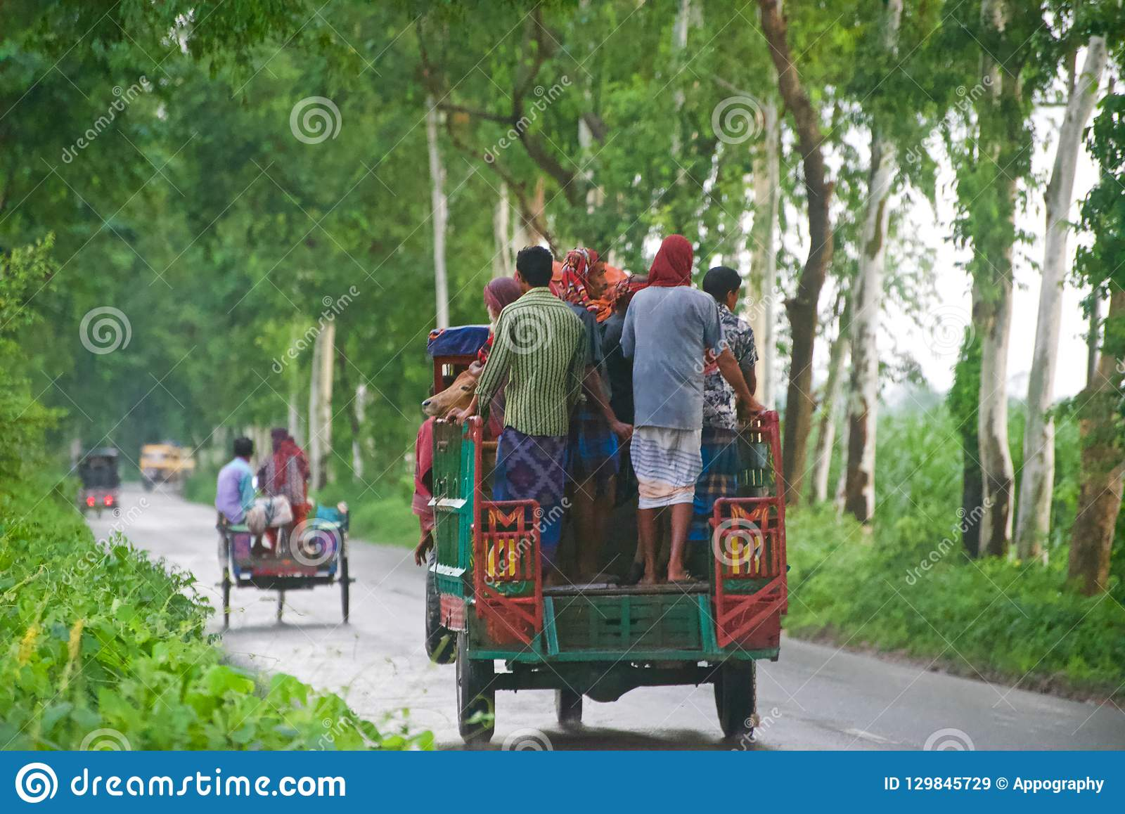 Bangladeshi people travelling on a three wheelers