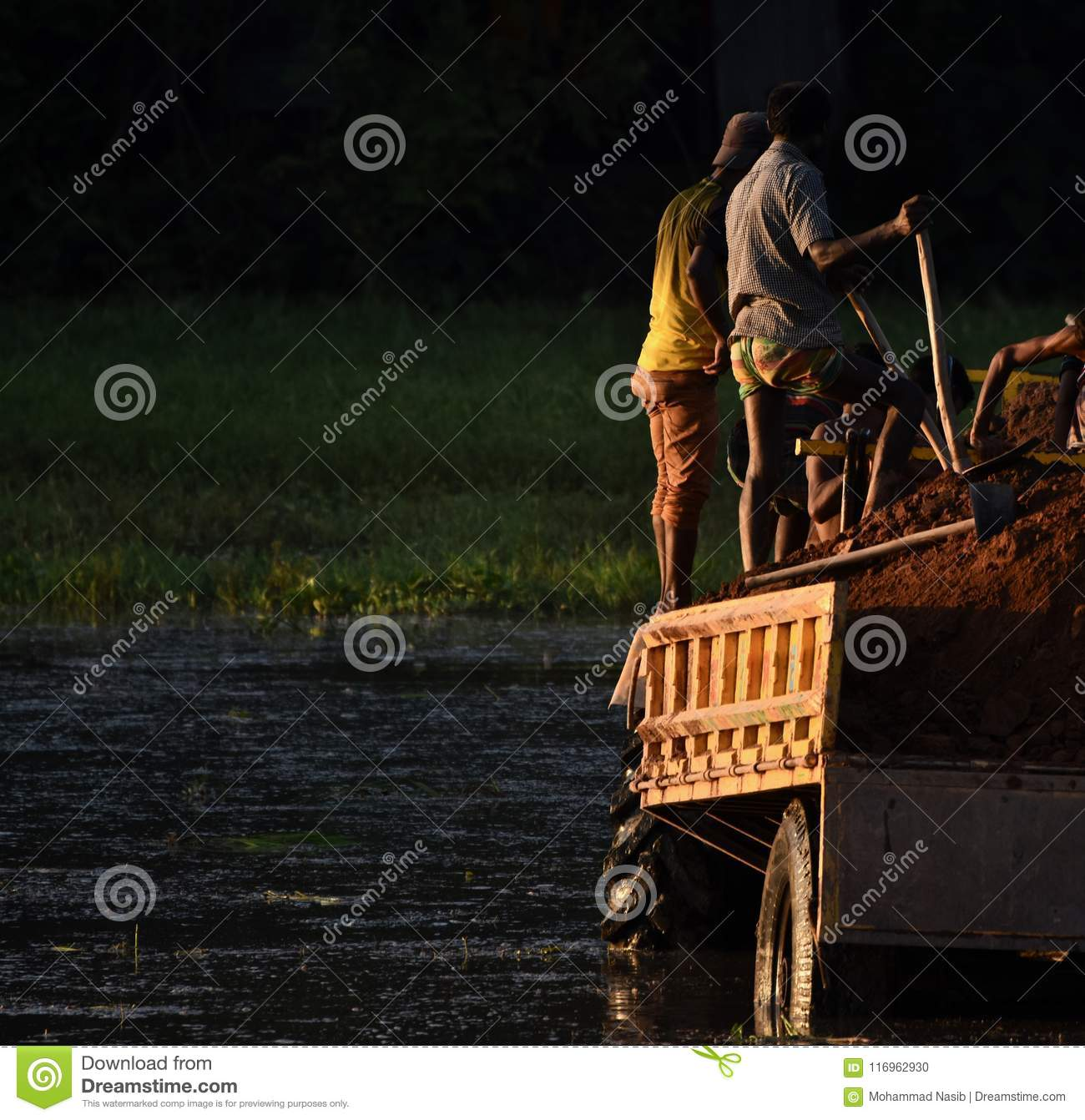 Download People Working Together On A Tractor Vehicle Unique Photo Editorial Image - Image of people, image: 116962930