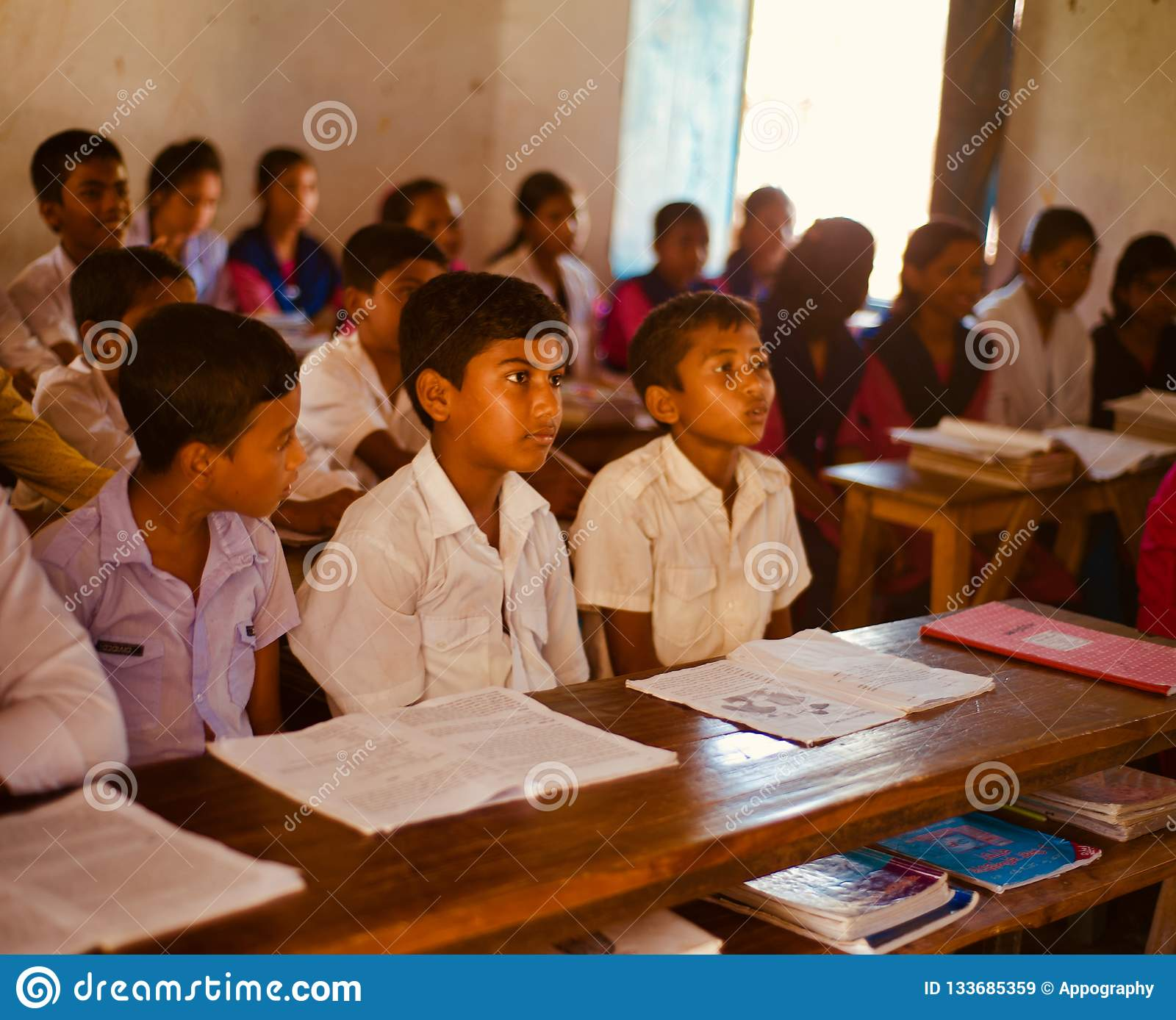 Young boys sitting around a classroom unique photo