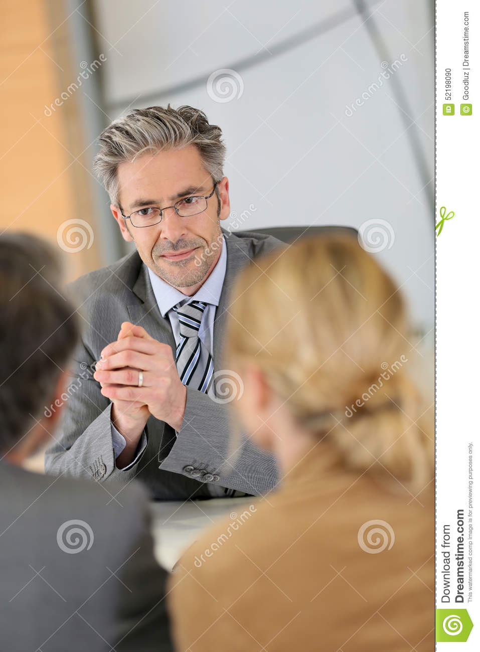 Banking consultant listening to clients