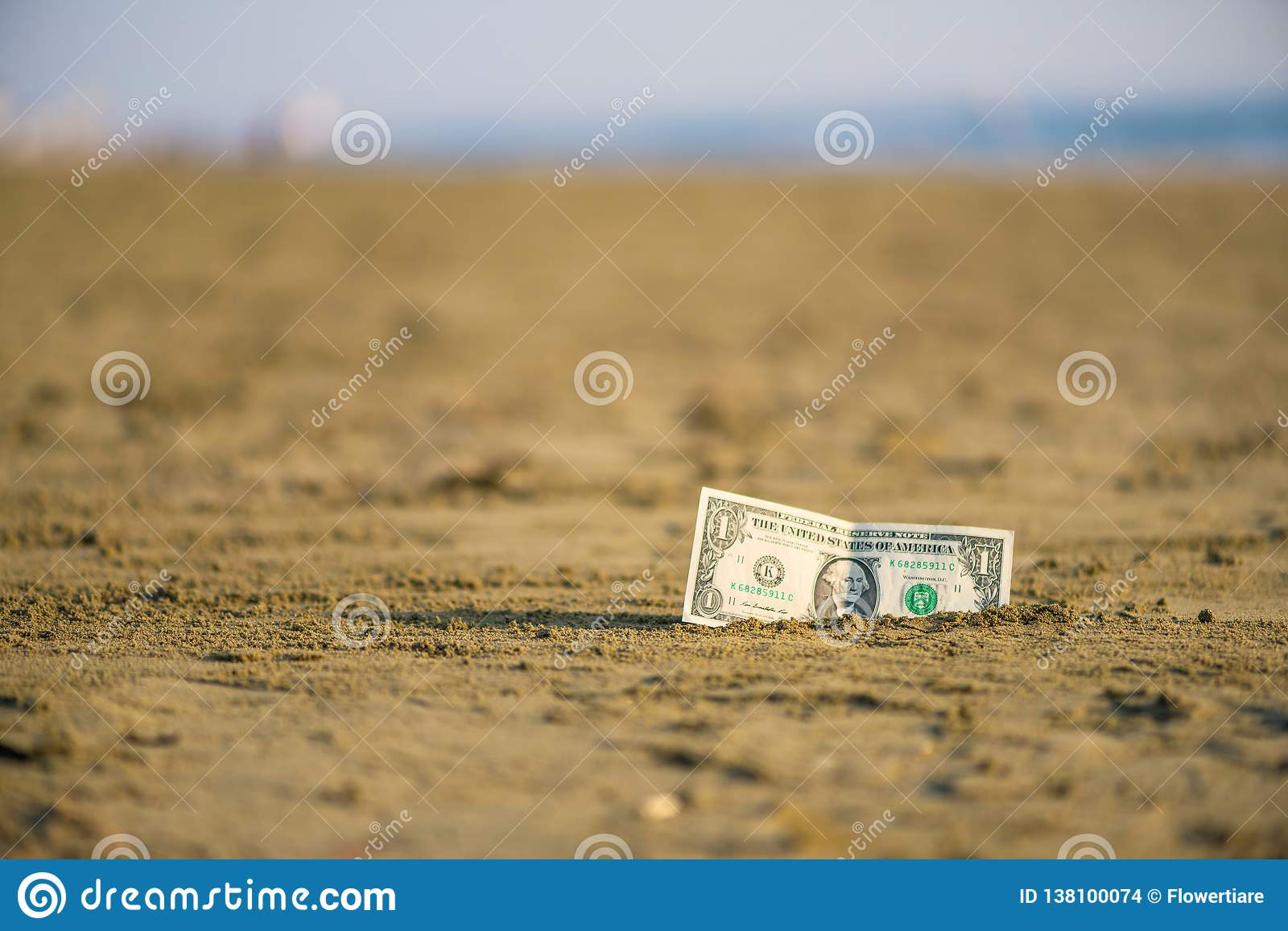 Banknote Of Value Of One Dollar In The The Sand On The Beach