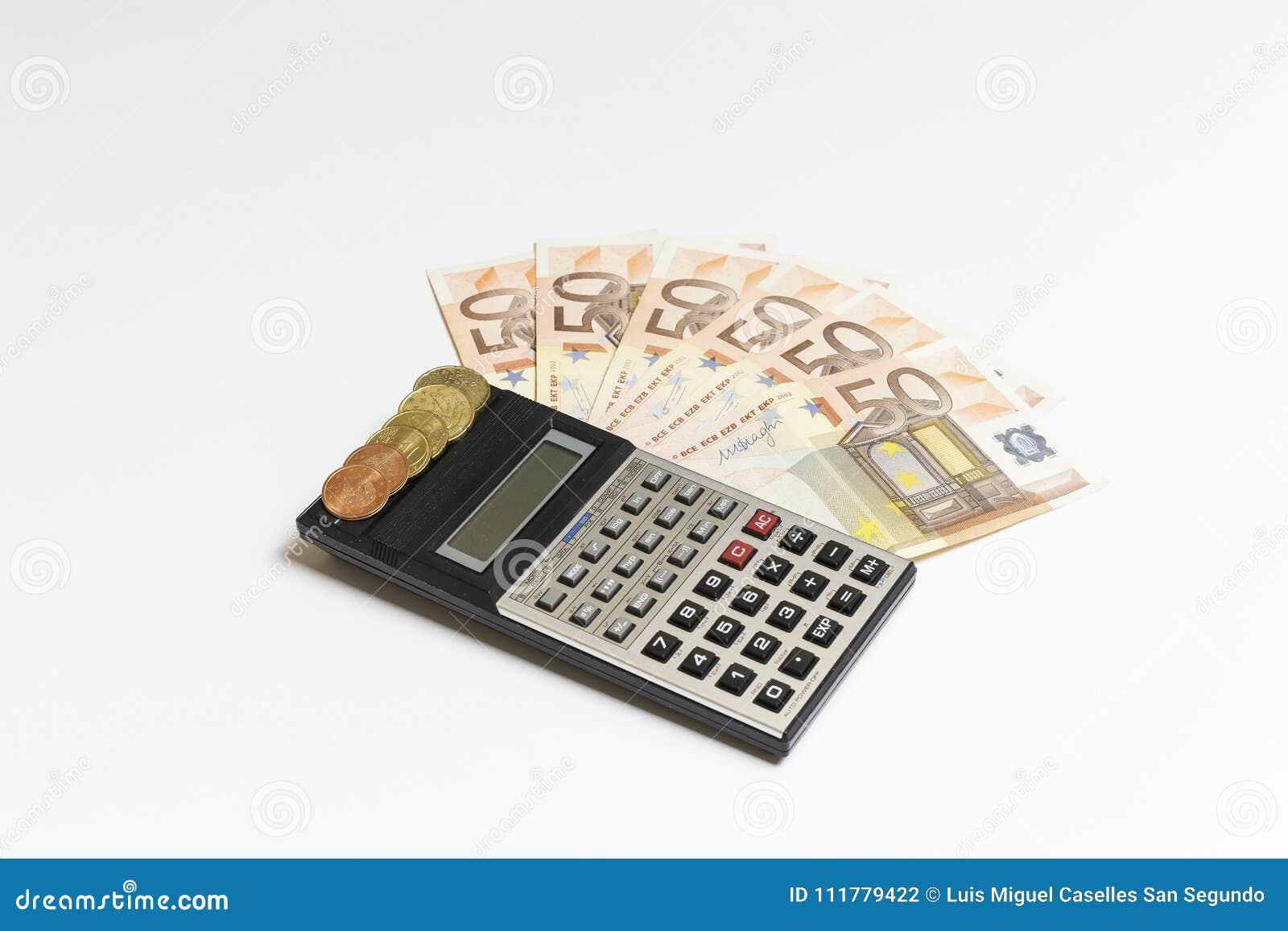 Banknotes, euro coins and a calculator