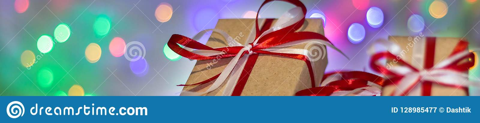 Banner of Christmas gift box against bokeh background. Holiday greeting card