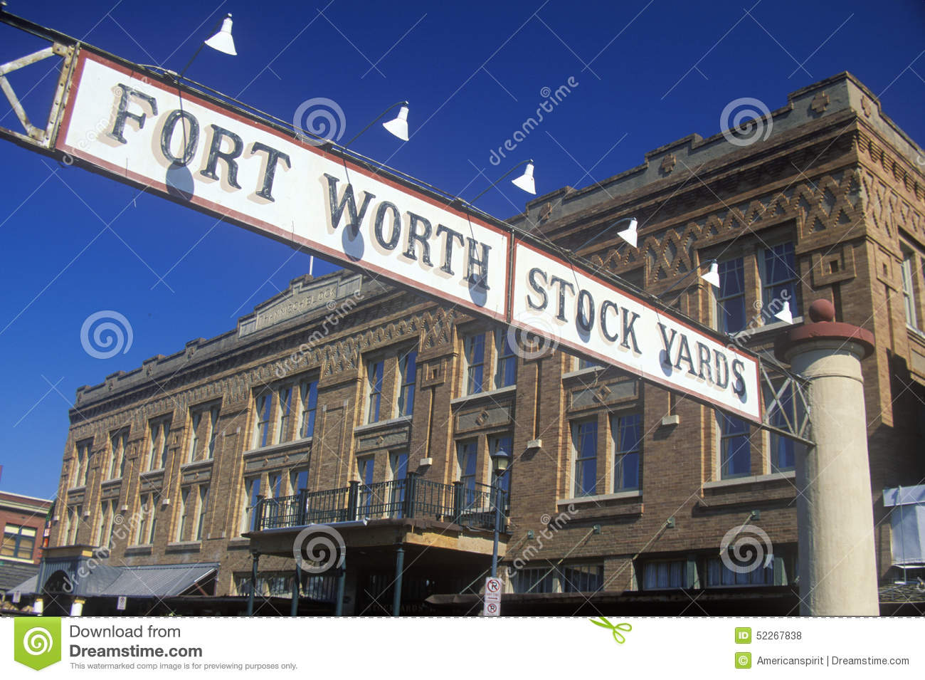 Banner at the Fort Worth Stock Yards with historic hotel, Ft. Worth, TX